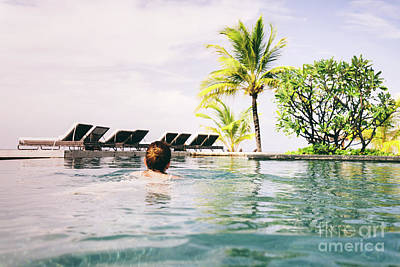 Photograph - Woman Swimming In A Hotel Pool In A Tropical Resort. by Michal Bednarek