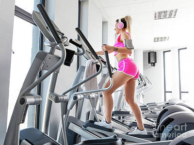 Muscular Photograph - Woman Training At Crosstrainer In A Gym. by Michal Bednarek