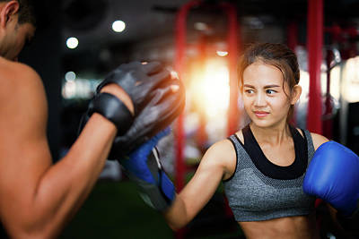 Kickboxing Photograph - Woman Ttaining For Fitness Boxing by Anek Suwannaphoom