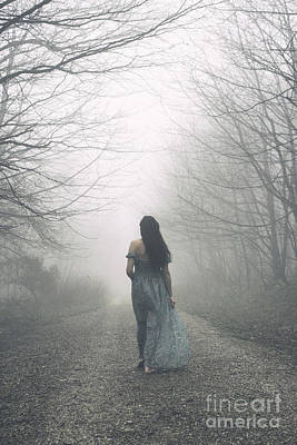 Photograph - Woman Walking Along Foggy Path by Clayton Bastiani