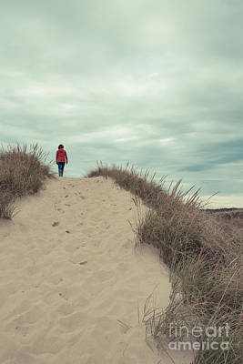 Cape Cod Photograph - Woman Walking In The Dunes Of Cape Cod by Edward Fielding