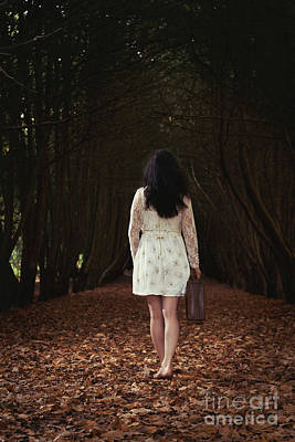 Country Lanes Photograph - Woman Walking Through Forest by Amanda Elwell