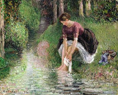 Woman Washing Her Feet In A Brook Art Print by Camille Pissarro