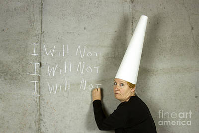 Dunce Caps Photograph - Woman With Dunce Cap Writing I Will Not by Karen Foley