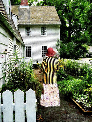 Woman With Striped Jacket And Flowered Skirt Art Print by Susan Savad