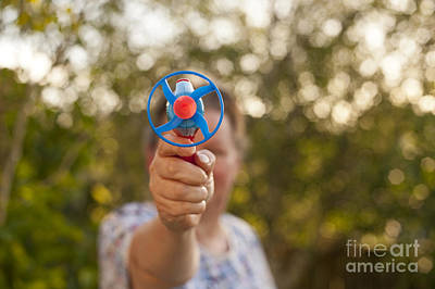 Photograph - Woman With Toy Dart Gun  by Jim Corwin