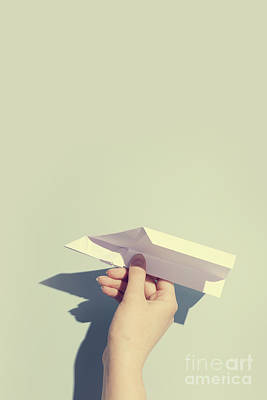 Photograph - Woman's Hand Playing With White Paper Plane by Michal Bednarek