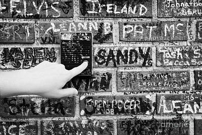 Womans Hand Pushing Old Intercom Button On Wall Covered In Graffiti Outside Graceland Memphis Art Print by Joe Fox