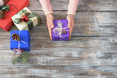 Photograph - Woman's Hands Giving Christmas Or Other Holiday Handmade Present by Julian Popov