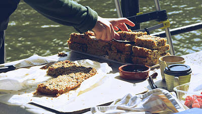 Photograph - Woman's Hands Slicing Cake At The Market Bakery Stall A by Jacek Wojnarowski