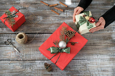 Photograph - Woman's Hands Wrapping Christmas Or Other Holiday Handmade Prese by Julian Popov