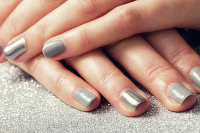 Photograph - Woman's Nails With Shiny Silver Hybrid Manicure by Michal Bednarek