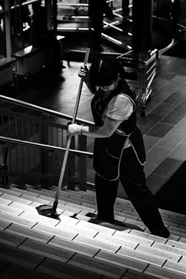 Photograph - Women Cleans Steps In Mega Store Ufa Russia 2015 by John Williams