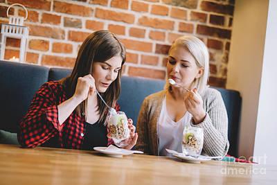 Photograph - Women Eating Healthy Dessert In A Restaurant. by Michal Bednarek