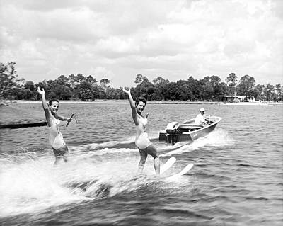 Swimsuit Photograph - Women Water Skiers Waving by Underwood Archives