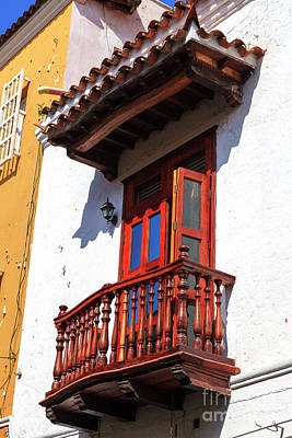 Wood Balcony In Cartagena Art Print by John Rizzuto