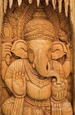 Photograph - wood carving for Hindu god Ganesha on the wood. by Tosporn Preede