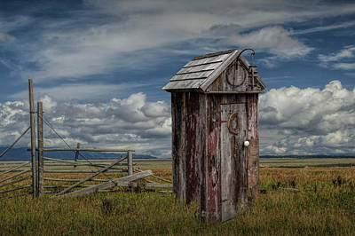 Randall Nyhof Royalty Free Images - Wood Outhouse out West Royalty-Free Image by Randall Nyhof