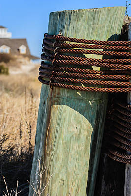 Photograph - Wood Piling Secured By Steel Cable by Joni Eskridge