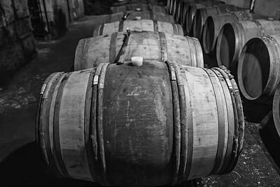 Vintage Wine Lovers Photograph - Wooden Barrels In A Wine Cellar by Georgia Fowler