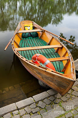 Wooden Boat With Oars And Lifebelt Print by Arletta Cwalina