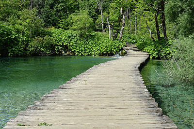 Vintage River Scenes Photograph - Wooden Bridge Over A Pond In Plitvice National Park With Retro S by Brandon Bourdages