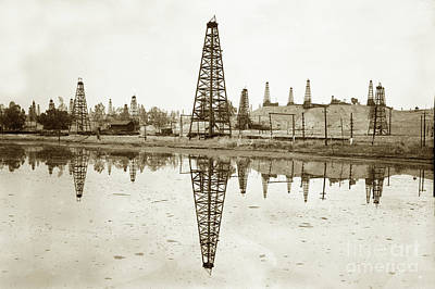 Photograph - wooden derrick reflection in  oil kak  California Oil Field circ by California Views Archives Mr Pat Hathaway Archives