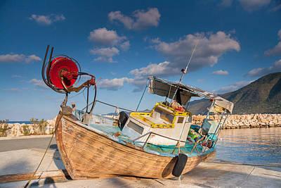 Wooden Fishing Boat On Shore Art Print by Iordanis Pallikaras