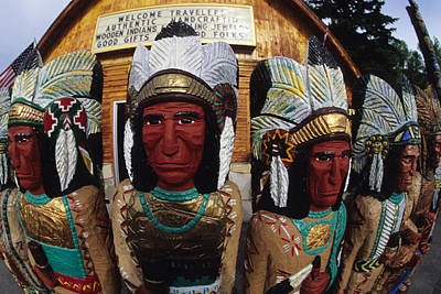 Wooden Indians Decorate A Store Front Art Print