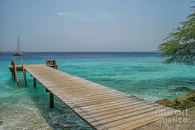 Photograph - Wooden Jetty In Ocean by Patricia Hofmeester