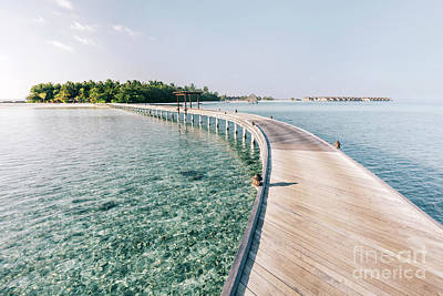 Photograph - Wooden Jetty Leading To A Tropical Island by Michal Bednarek