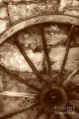 Photograph - Wooden Wagon Wheel by Imagery by Charly