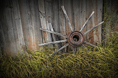 Photograph - Wooden Wagon Wheel Spokes Against Wood Barn Siding by Randall Nyhof