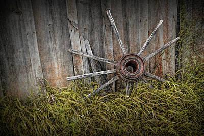 Wagon Wheel Hub Wall Art - Photograph - Wooden Wagon Wheel Spokes Against Wood Barn Siding by Randall Nyhof