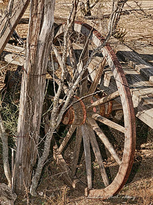 Photograph - Wooden Wheel by Charles McKelroy