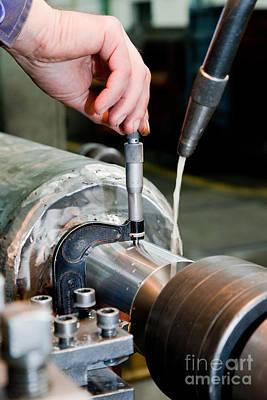 Metal Photograph - Worker Measuring On Industrial Turning Machine by Michal Bednarek