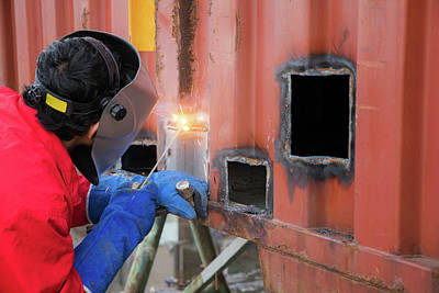 Arc Welder Photograph - Worker Repair Container Box By Gas Cutting And Welding by Anek Suwannaphoom