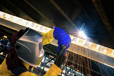 Arc Welder Photograph - Worker Welding For Repair Bottom Side Of Container Box by Anek Suwannaphoom