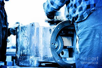 Worker Photograph - Workers Repair Work On Old Gear Element In Workshop by Michal Bednarek
