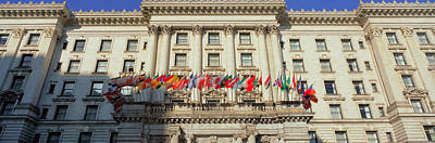 World Flags Blow In The Breeze In Front Art Print by Panoramic Images