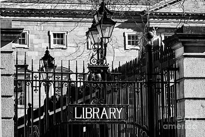 Gas Lamp Photograph - wrought iron gates and old gas lights at the entrance to the national library Dublin Republic of Ire by Joe Fox