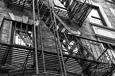 Photograph - Wrought Iron Fire Escape In The Village by John Rizzuto