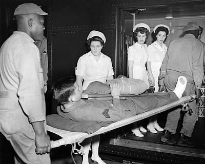 Healthcare And Medicine Photograph - Wwii Wounded Soldiers Return by Underwood Archives