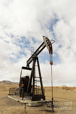 Photograph - Wyoming Industrial Oil Pump Jack Fracking Crude Extraction Machine by Christopher Boswell