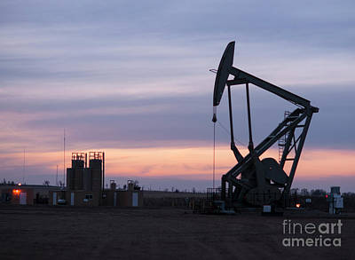 Photograph - Wyoming Oil Pump Jack Fracking Crude Extraction Machine by Christopher Boswell