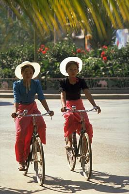 Red Travelpics Photograph - Xishuangbanna Cyclists by Travel Pics