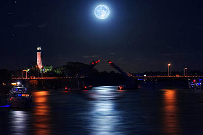 Photograph - Yacht Passing Through Jupiter Inlet And Lighthouse Under The Full Snow Moon. by Justin Kelefas