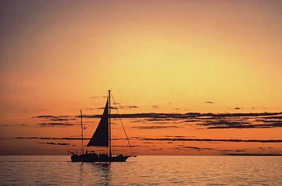 Photograph - Yacht Silhouette On Orange Sea With Setting Sun by David Halperin