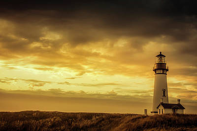 Photograph - Yaquina Head Lighthouse At Sunset by Don Schwartz
