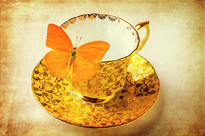 Yellow Butterfly On Yellow Tea Cup Art Print